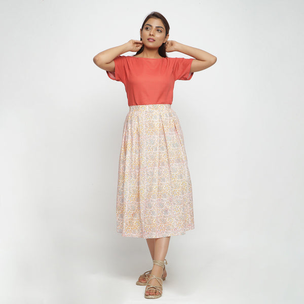 Front View of a Model wearing Block Printed Floral Pleated Skirt