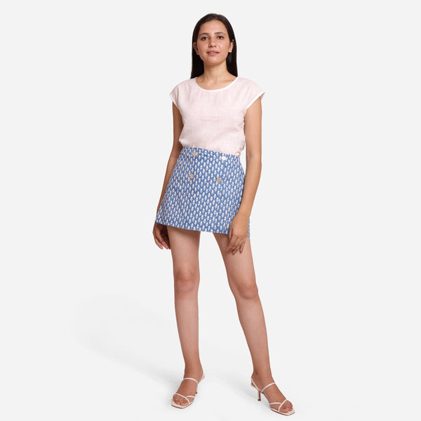 Front View of a Model wearing Blue Button-Wrap Mini Skirt
