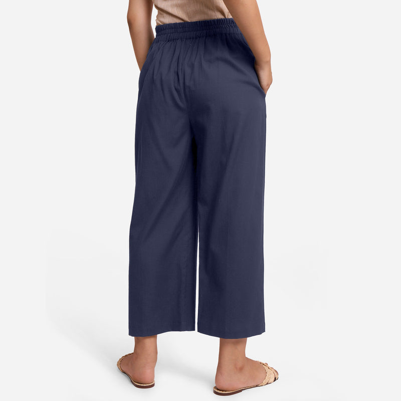 Back View of a Model wearing Blue Cotton Flax Wide Legged Pant