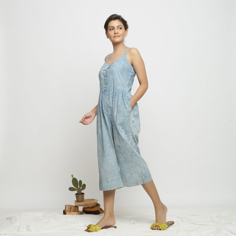 Left View of a Model wearing Blue Dabu Printed Button-Down Jumpsuit