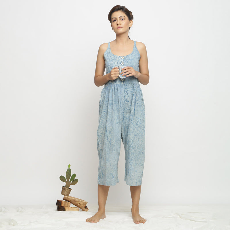 Front View of a Model wearing Blue Dabu Printed Button-Down Jumpsuit