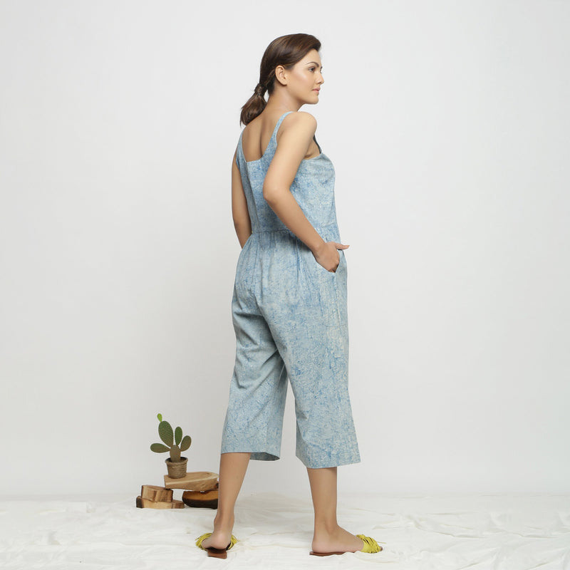 Back View of a Model wearing Blue Dabu Printed Button-Down Jumpsuit