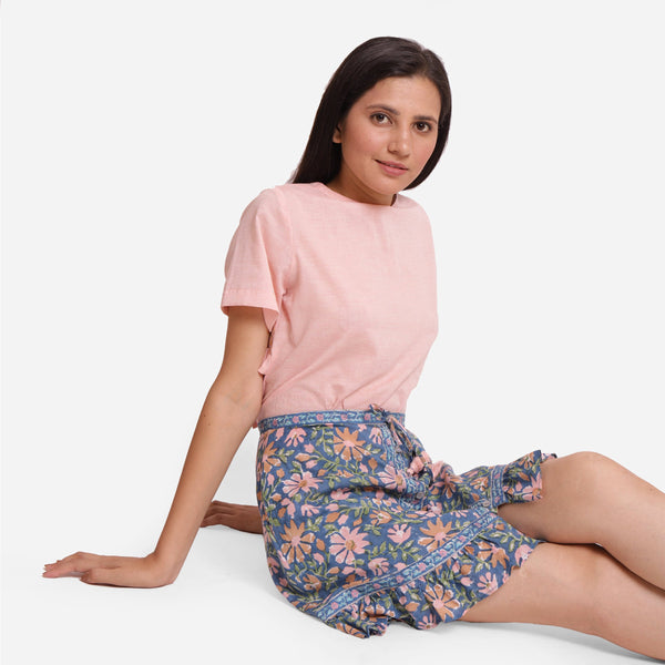 Right View of a Model wearing Blue Cotton Floral Button-Down Skirt