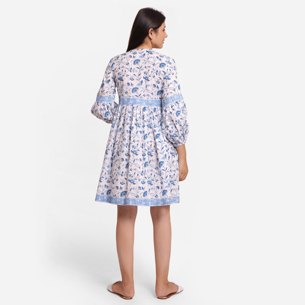 Back View of a Model wearing Blue Floral Fit and Flare Cotton Dress