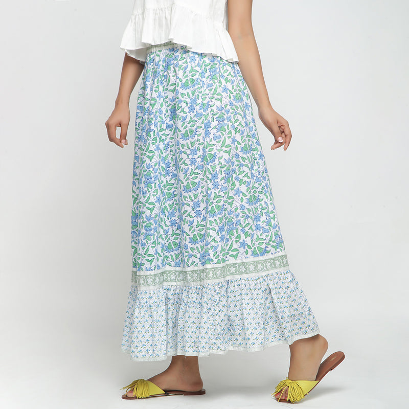 Left View of a Model wearing Blue Printed Flowy Paneled Skirt