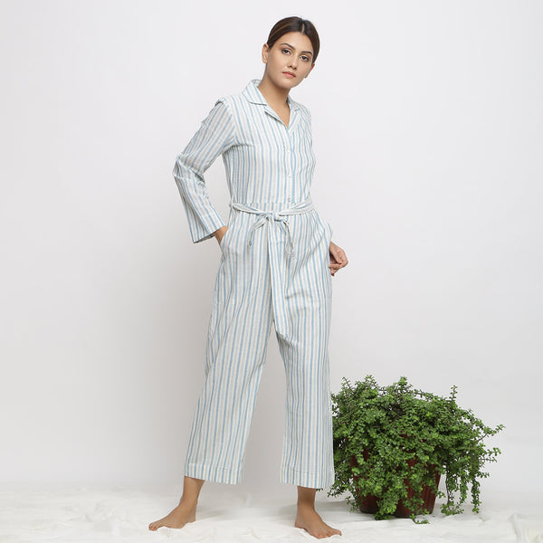 Right View of a Model wearing Blue Handspun Button-Down Jumpsuit