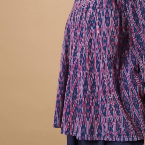 Left Detail of a Model wearing Blue Ikat Paneled Godet Flared Top