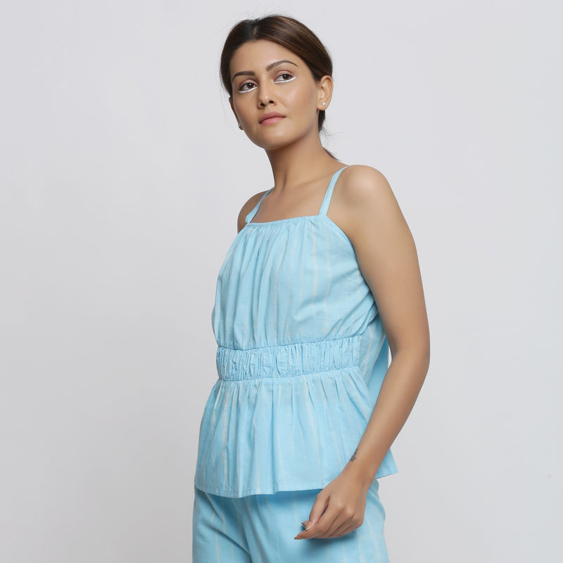 Left View of a Model wearing Blue Tie-Dye Flared Camisole Top