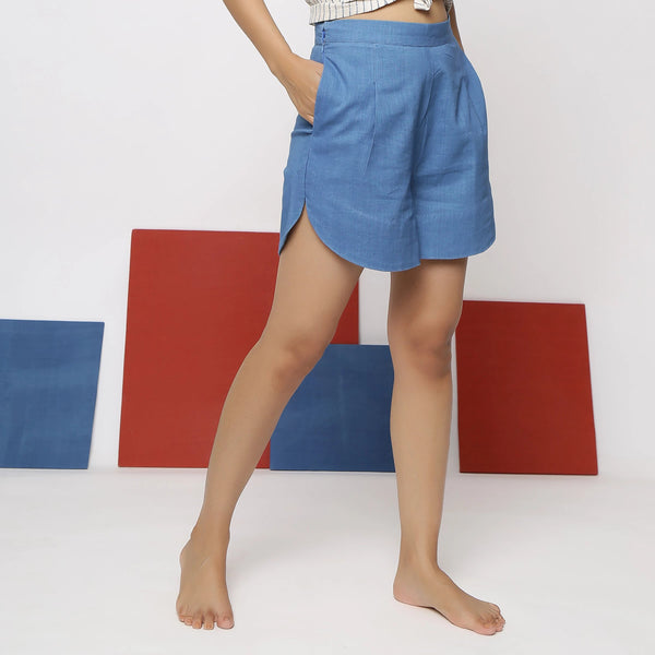 Right View of a Model wearing Blue Vegetable Dyed Straight Fit Shorts