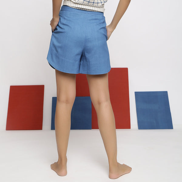 Back View of a Model wearing Blue Vegetable Dyed Straight Fit Shorts