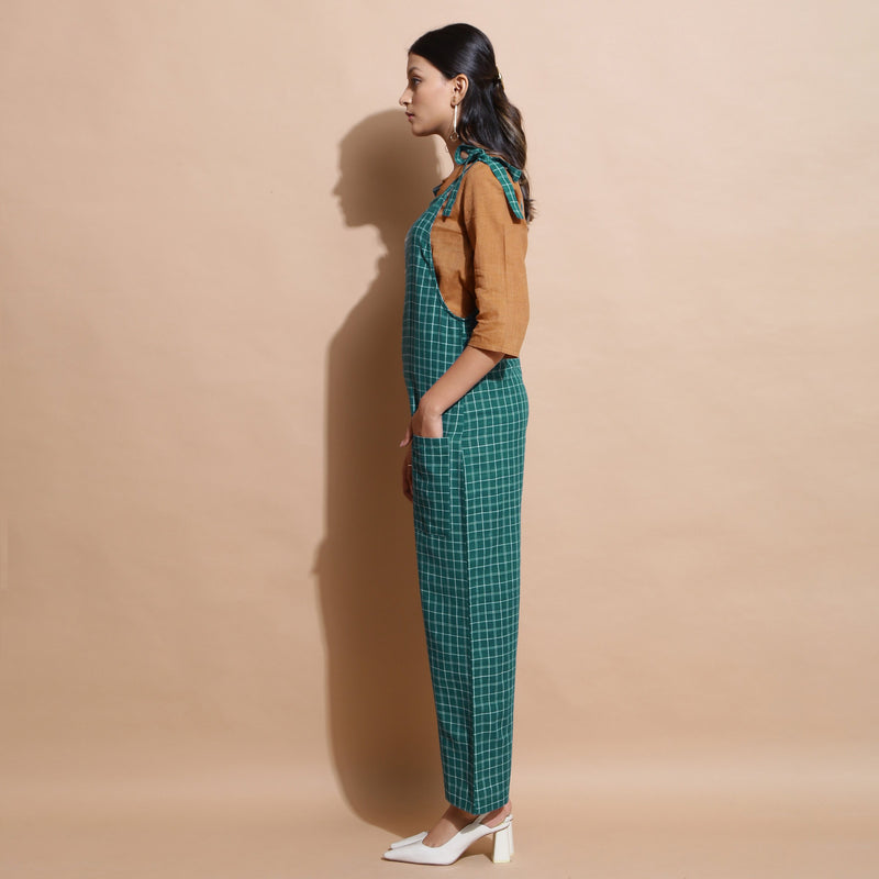 Left View of a Model wearing Bottle Green Cotton Ankle-Length Dungaree