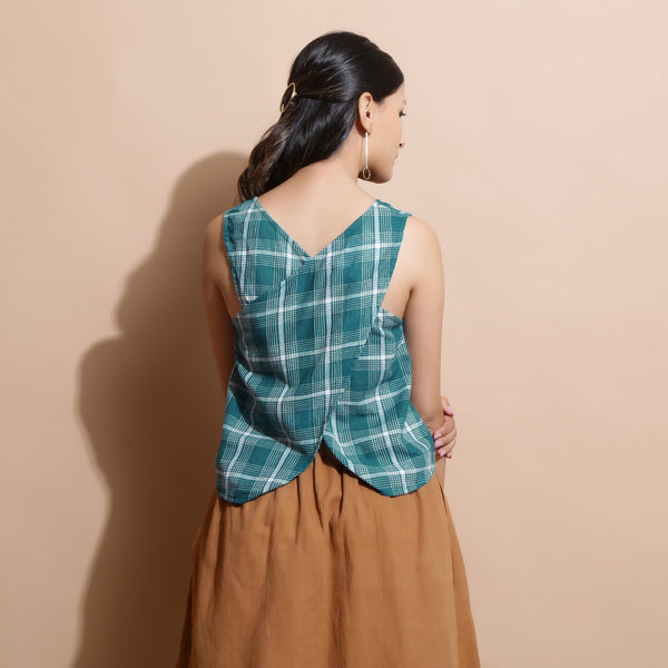 Back View of a Model wearing Bottle Green Handspun Cotton Sleeveless Straight Top