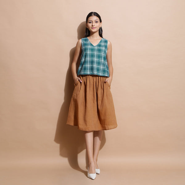 Front View of a Model wearing Bottle Green Handspun Cotton Sleeveless Straight Top