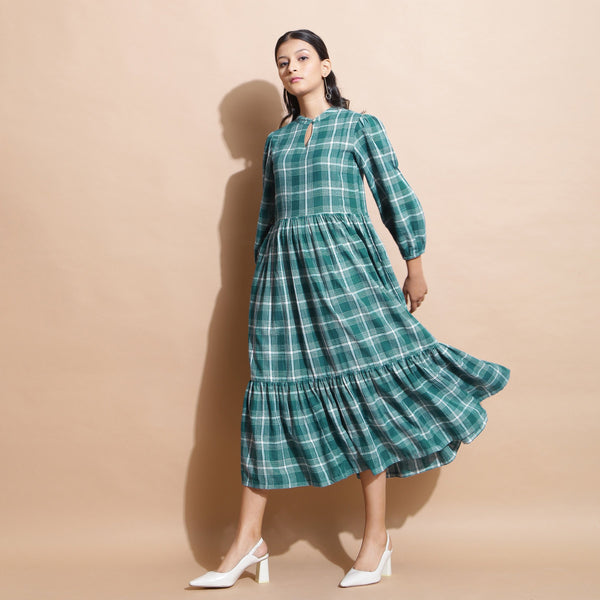 Front View of a Model wearing Bottle Green Puff Sleeves Gathered Dress