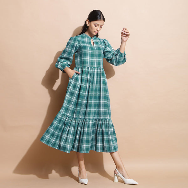 Right View of a Model wearing Bottle Green Puff Sleeves Gathered Dress