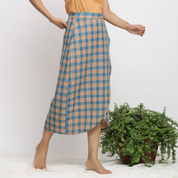 Right View of a Model wearing Bottle Green Handspun Wrap Skirt