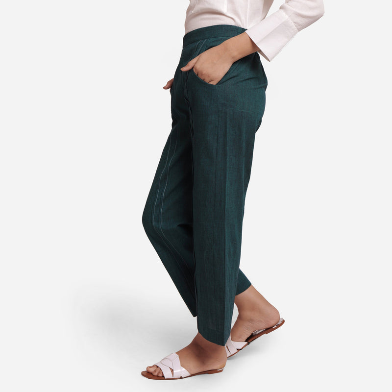 Left View of a Model wearing Bottle Green Mid Rise Straight Fit Pant