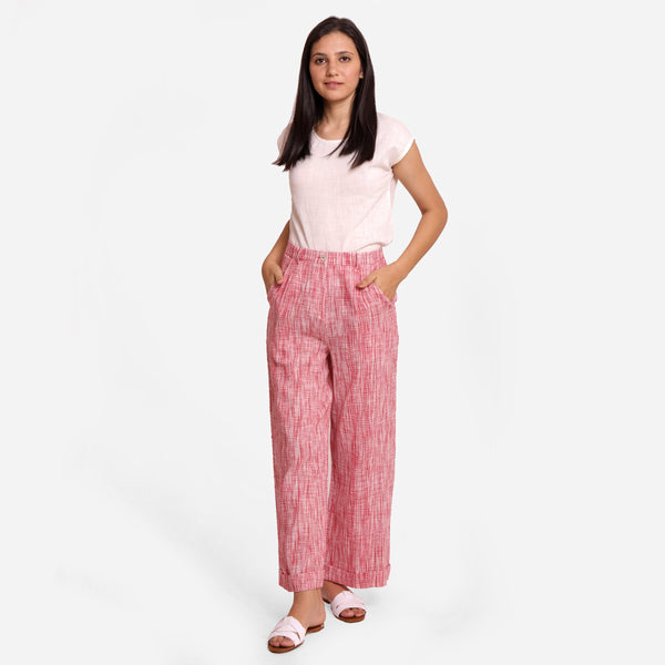 Front View of a Model wearing Red Crinkled Cotton Ankle Length Pant