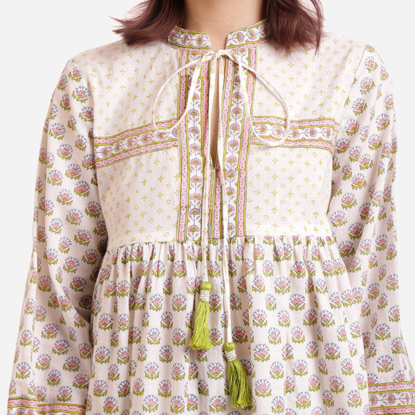 Front Detail of a Model wearing White Floral Pattern Peasant Dress