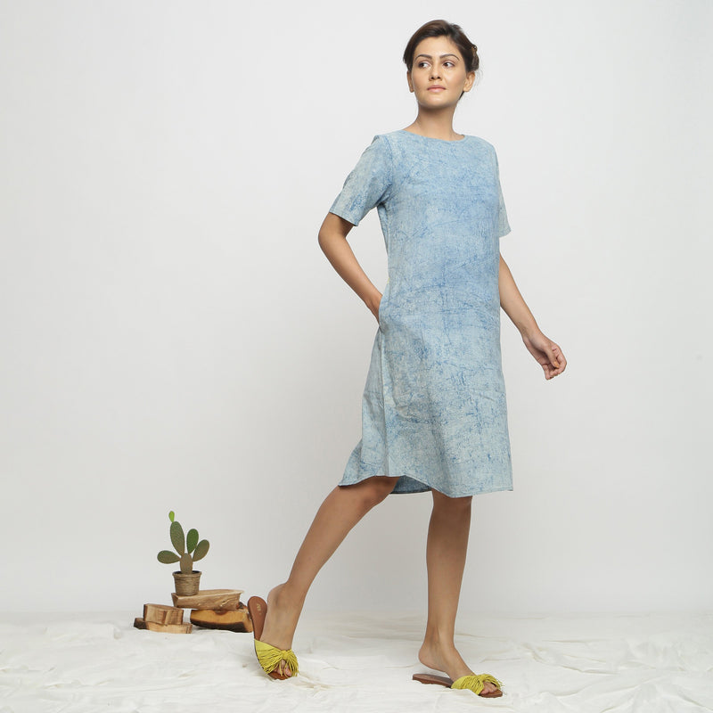 Right View of a Model wearing Blue Dabu Print Hand Embroidered Dress