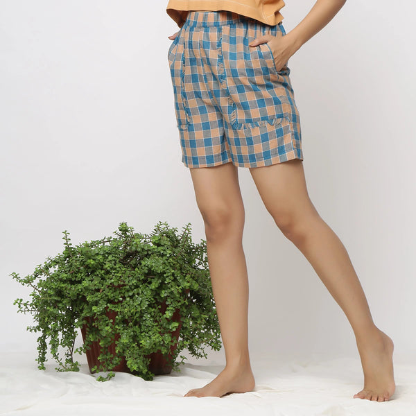 Left View of a Model wearing Breezy Handspun Cotton Checks Shorts