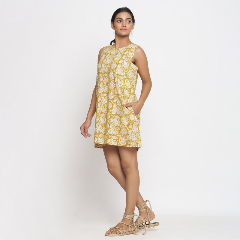 Left View of a Model wearing Bagru Print Mustard Shift Dress