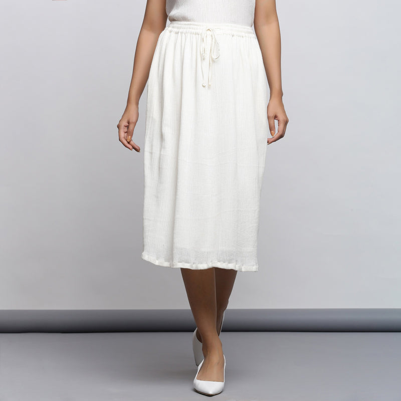 Front View of a Model wearing Off-White Crinkled Cotton Flared Skirt