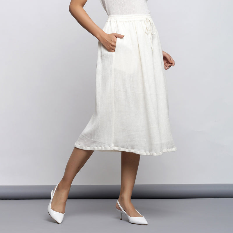 Right View of a Model wearing Off-White Crinkled Cotton Flared Skirt