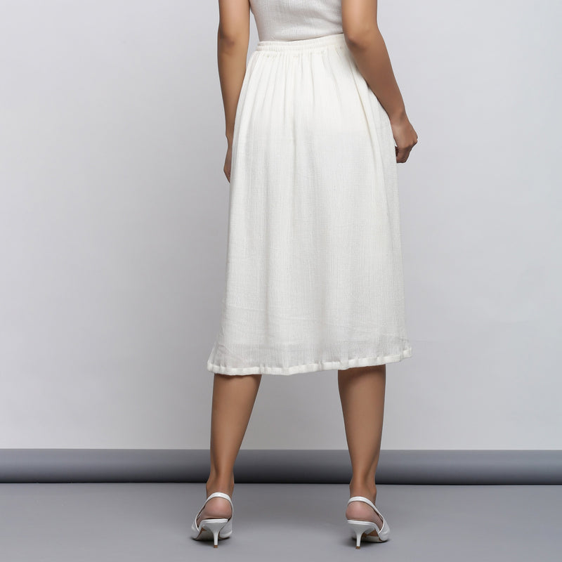 Back View of a Model wearing Off-White Crinkled Cotton Flared Skirt
