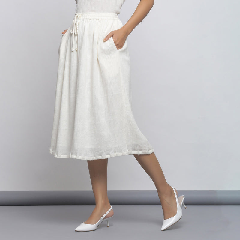 Left View of a Model wearing Off-White Crinkled Cotton Flared Skirt