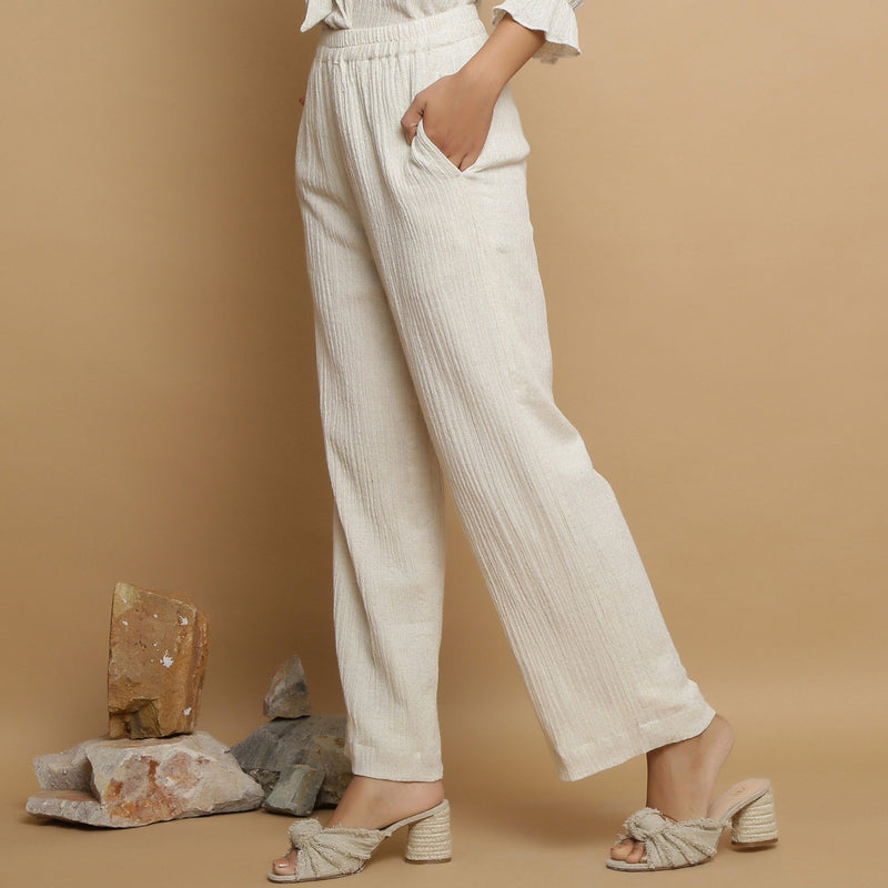Left View of a Model wearing Undyed Elasticated Mid Rise Ecru Pant
