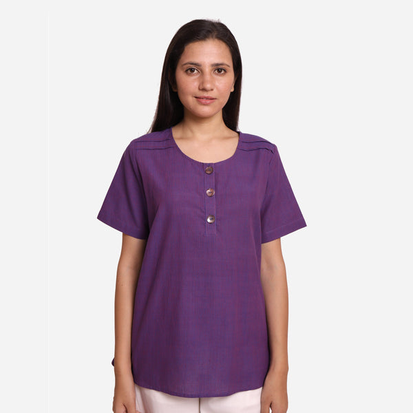 Front View of a Model wearing Breezy Violet Round Neck Flared Top
