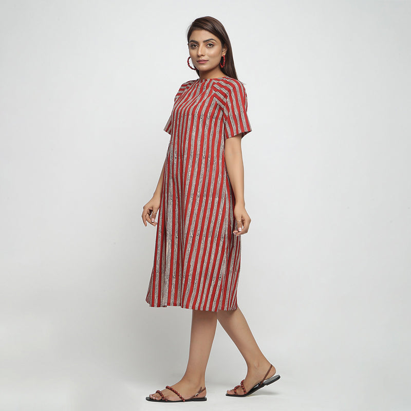 Left View of a Model wearing Brick Red Bagru Print Asymmetrical Dress