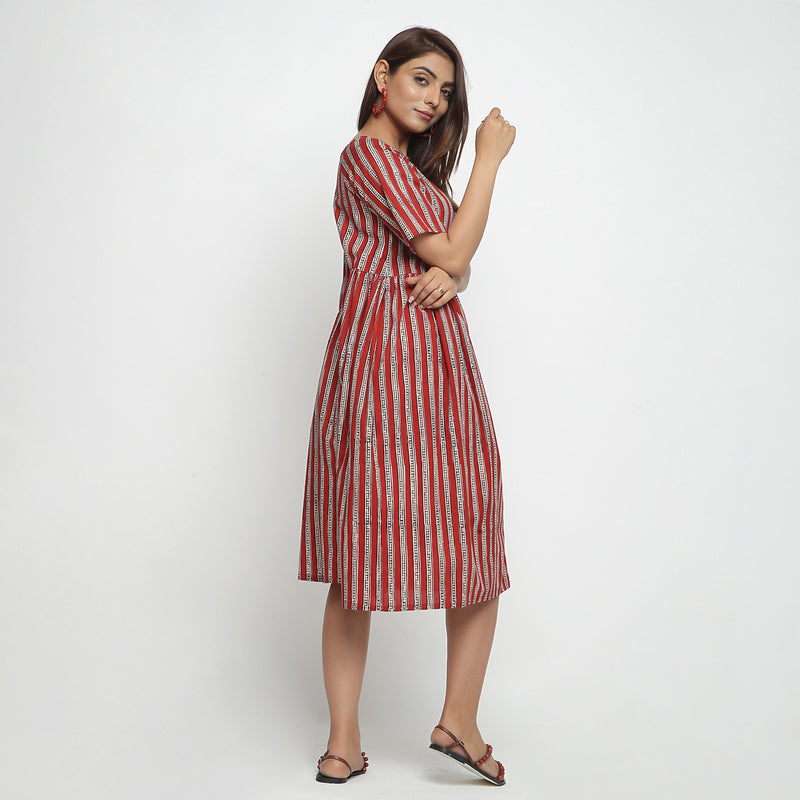 Right View of a Model wearing Brick Red Bagru Asymmetrical Midi Dress