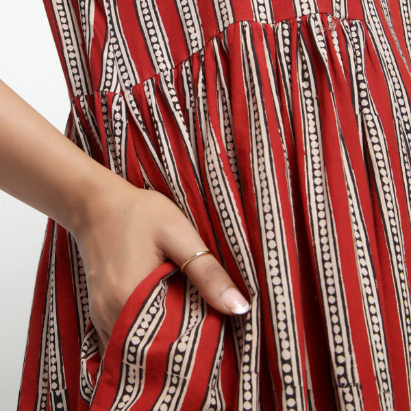 Close View of a Model wearing Brick Red Bagru Asymmetrical Midi Dress