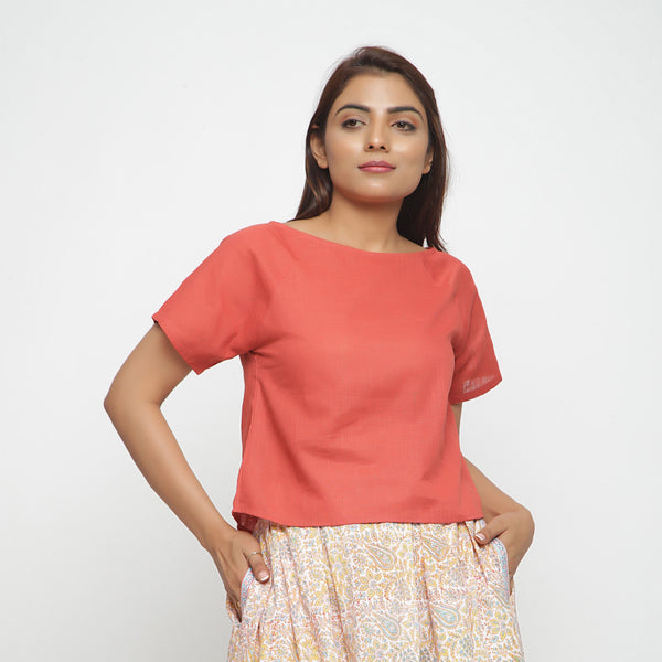 Front View of a Model wearing Brick Red Boat Neck Half Sleeve Cotton Top