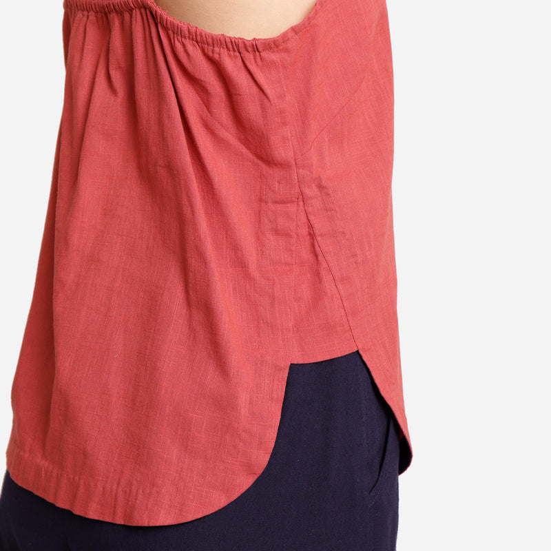 Right Detail of a Model wearing Brick Red Cotton Spaghetti Strap Top