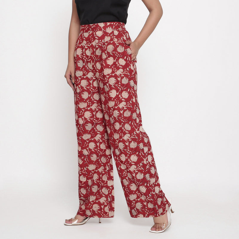 Left View of a Model wearing Brick Red Block Print Wide Legged Pant