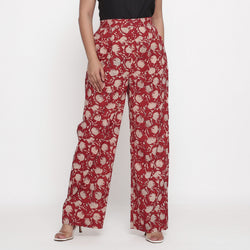 Front View of a Model wearing Brick Red Block Print Wide Legged Pant
