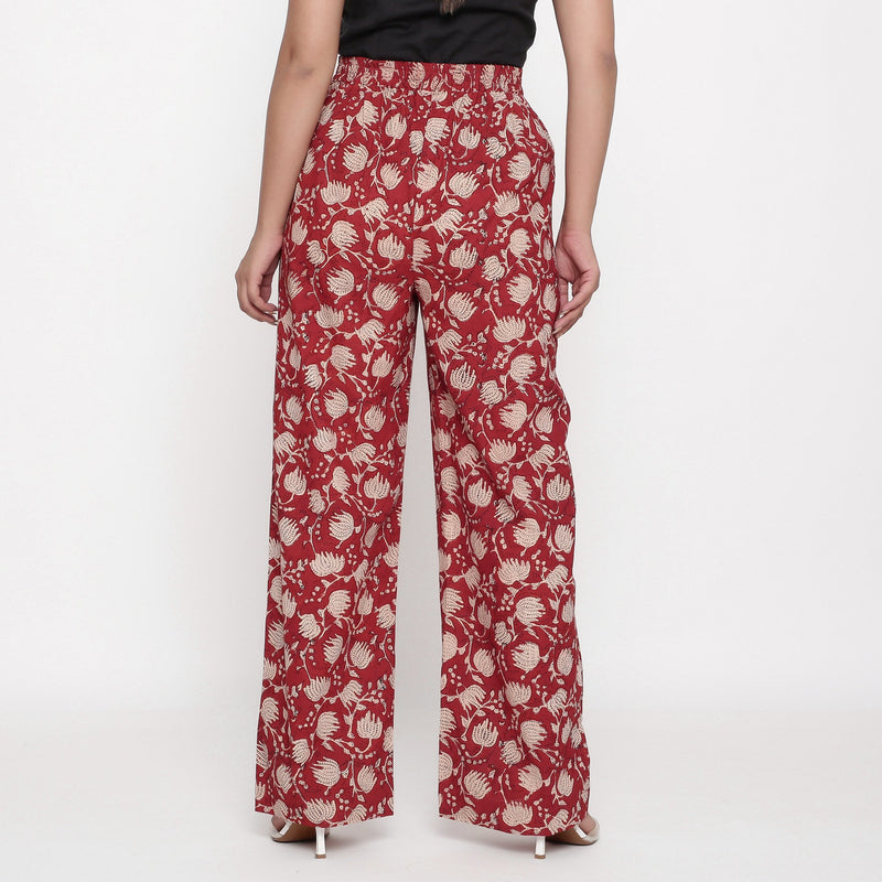 Back View of a Model wearing Brick Red Block Print Wide Legged Pant