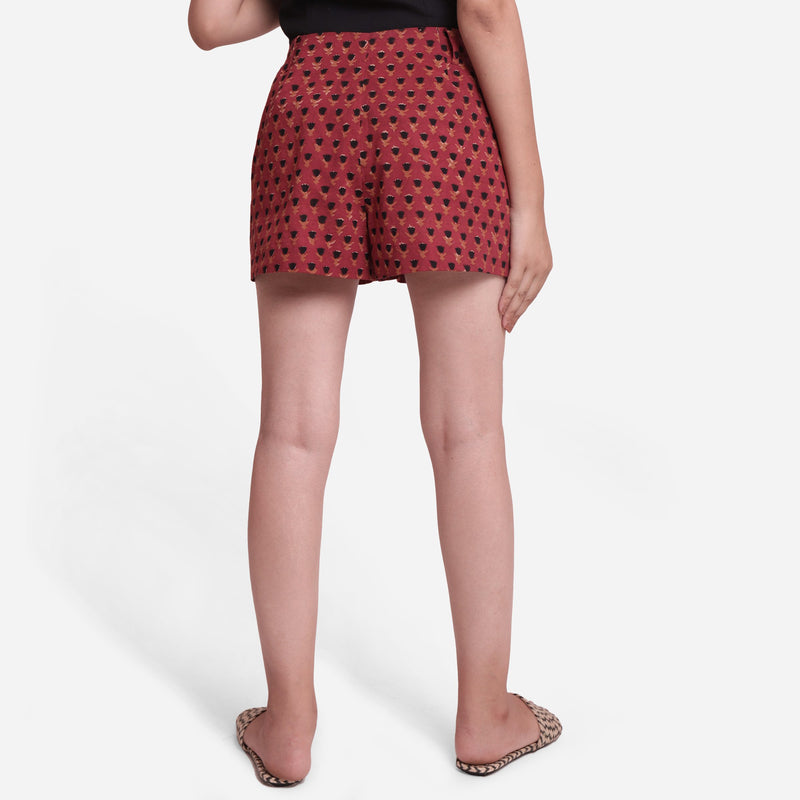 Back View of a Model wearing Brick Red Block Print Floral Hot Pants