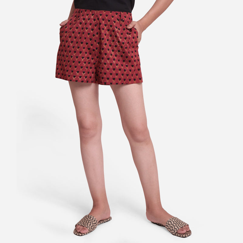 Front View of a Model wearing Brick Red Block Print Floral Hot Pants