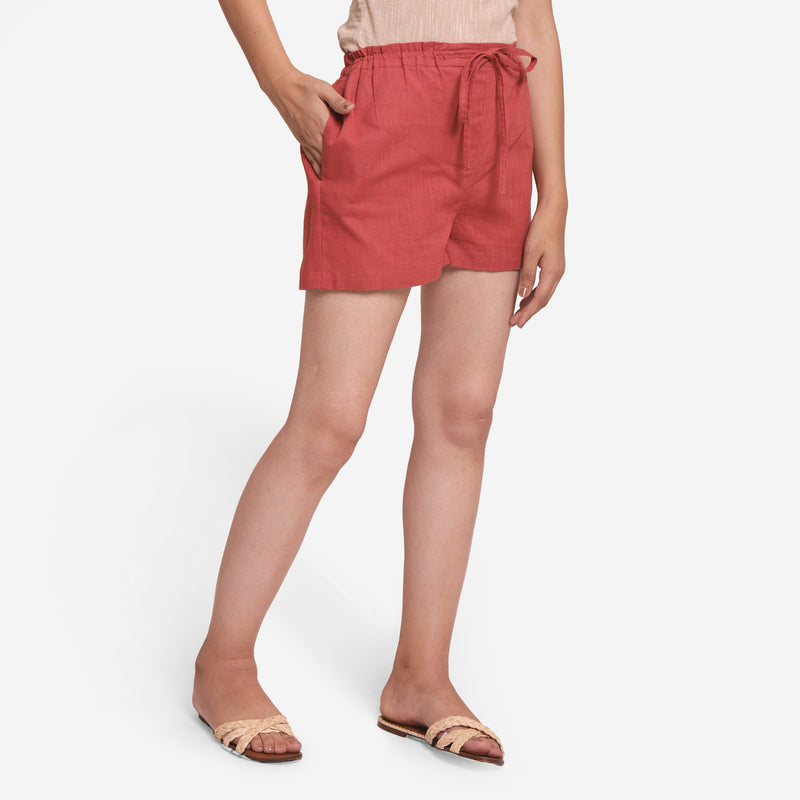 Right View of a Model wearing Brick Red Cotton Straight Shorts