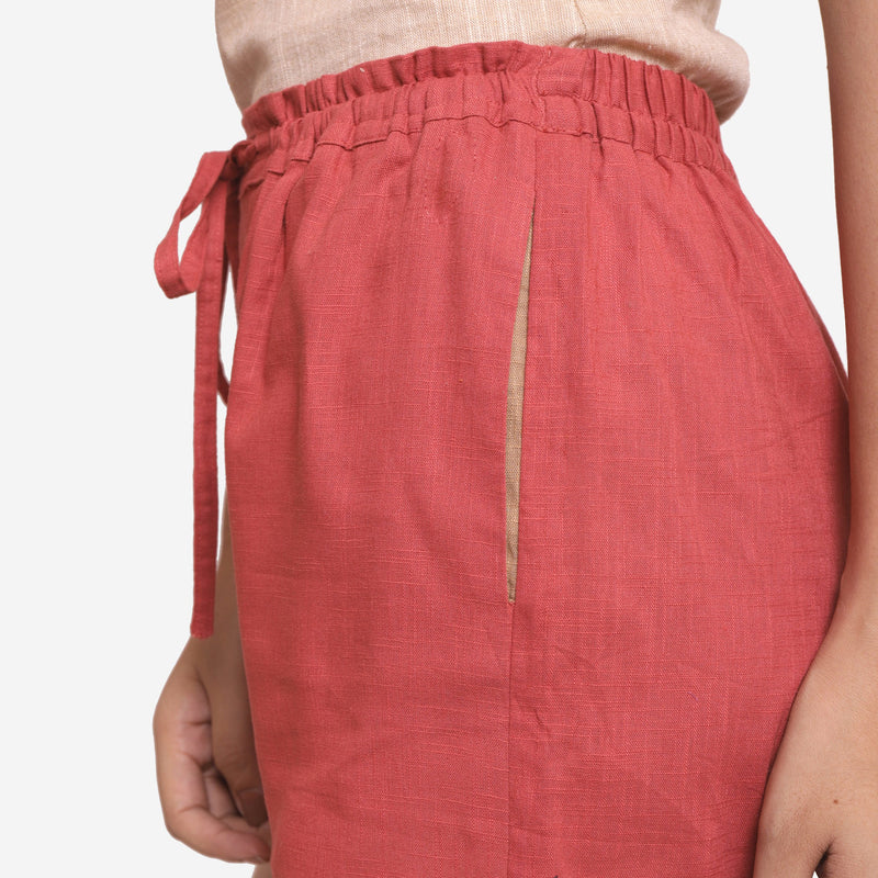 Left Detail of a Model wearing Brick Red Cotton Straight Shorts