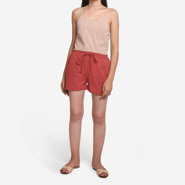 Front View of a Model wearing Brick Red Mid-Rise Straight Shorts