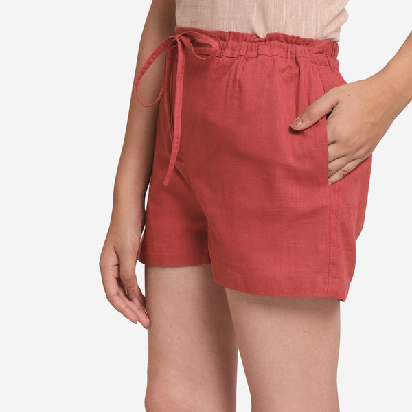 Left View of a Model wearing Brick Red Mid-Rise Straight Shorts