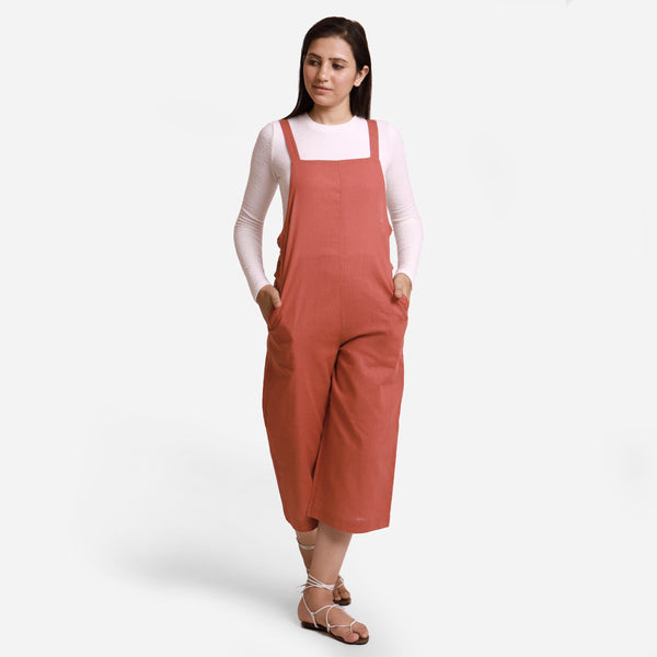 Front View of a Model wearing Brick Red Pinafore Midi Length Dungaree