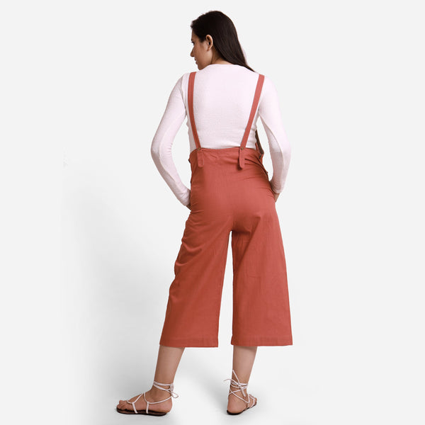 Back View of a Model wearing Brick Red Pinafore Midi Length Dungaree