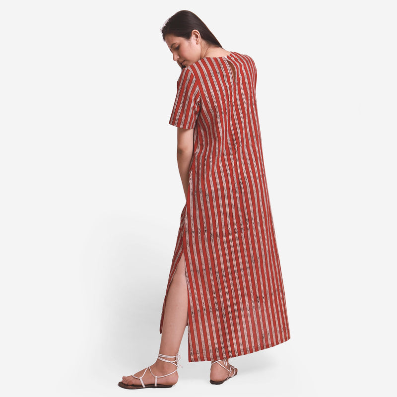 Back View of a Model wearing Brick Red Block Printed Maxi Dress