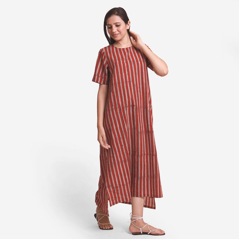 Front View of a Model wearing Brick Red Block Printed Maxi Dress